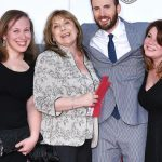 Chris Evans with his mother and two sisters