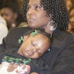 Draymond Green's mother Mary Babers, holding her granddaughter Amaria Babers,