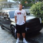 Blake Griffin with his car GMC