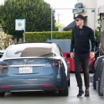 Blake Griffin with his car Tesla