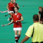 Emma Watson playing hockey