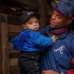 Cam Newton with his son
