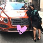 Cardi B with her car