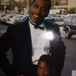 Marshawn Lynch as a child with his father