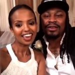 Marshawn Lynch with his wife