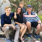 Brandy Halladay with her husband and sons