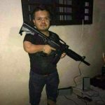 El Pirata de Culiacan holding a weapon