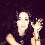Emmy Rossum Drinking
