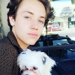 Ethan Cutkosky With His Pet Dog