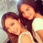 Michelle Phan with her sister Christine