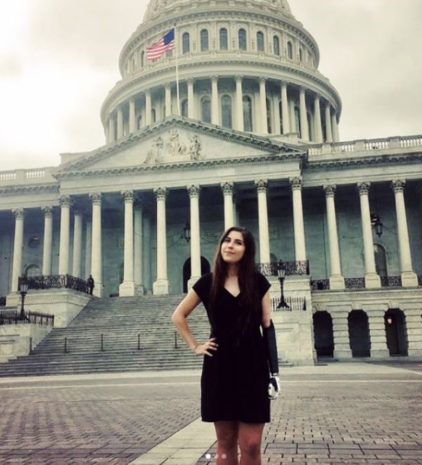 Angel Giuffria standing in front of Capitol Hill