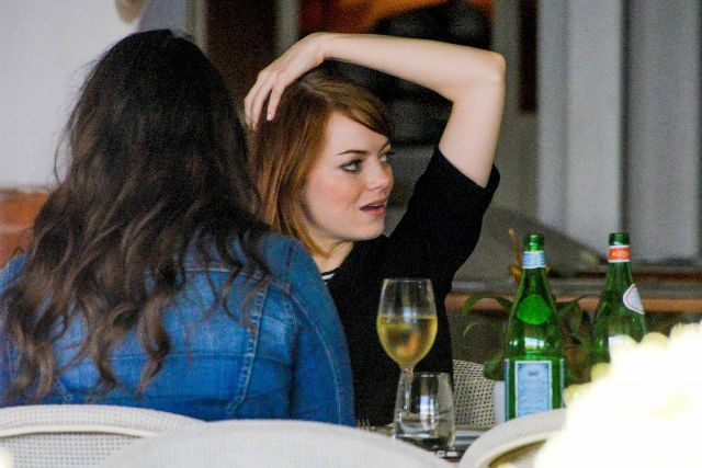 Emma Stone with a glass of wine
