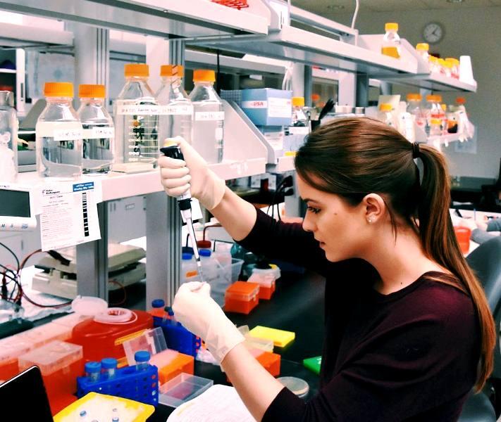 Camille Schrier working in a lab