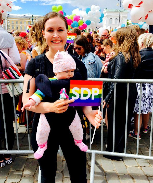 Sanna Marin with her daughter Emma attending a pride parade in Helsinki