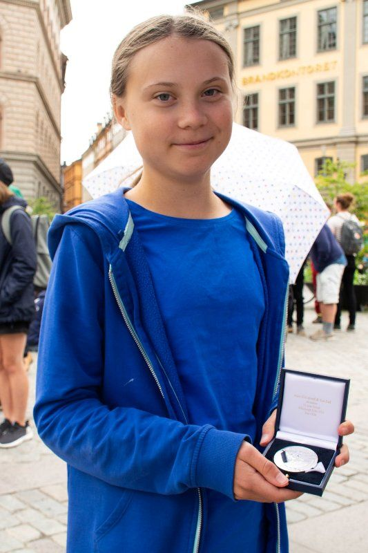 Greta Thunberg showing her Geddes Environment Medal