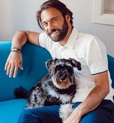 Cavit Çetin Güner with one of his pet dogs