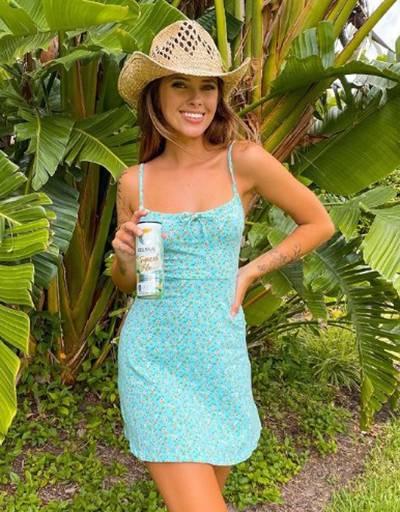 Emily Zeck advertising for Celcius energy drinks