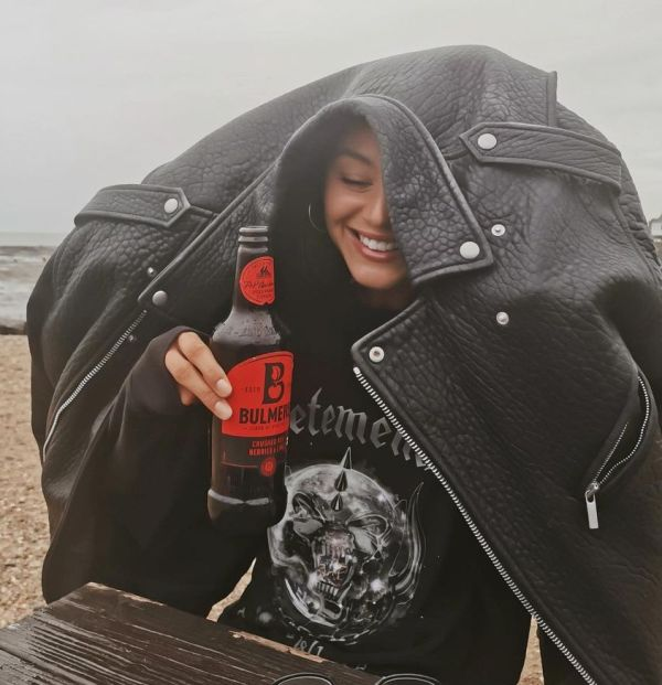 Eleanor Calder consuming Bulmers Crushed Red Berries & Lime Cider