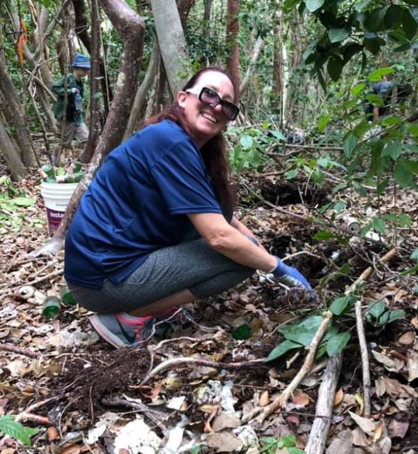Narelle Prew clearing buried bottles to avoid soil pollution