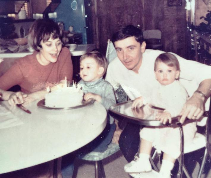 Childhood picture of Jillian Fink with her parents and sister