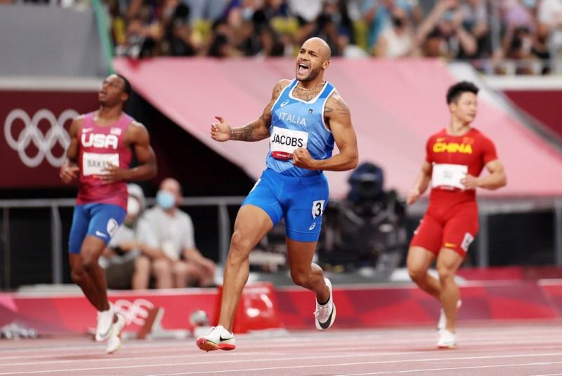 Lamont Marcell Jacobs celebrating his victory after winning the 100m event at the 2020 Summer Olympics