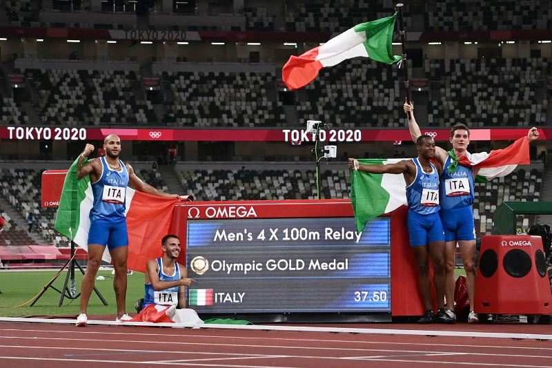 Lamont Marcell Jacobs celebrating his victory with other members of the Italian team in the 4×100 m relay event at the 2020 Tokyo Olympics