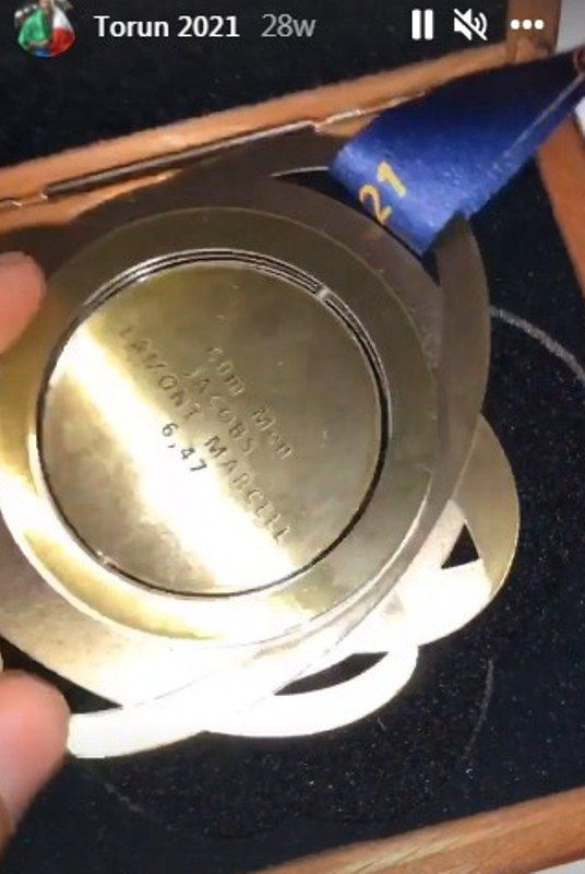Lamont Marcell Jacobs showing the gold medal he won at the 2021 European Athletics Indoor Championships in an Instagram story