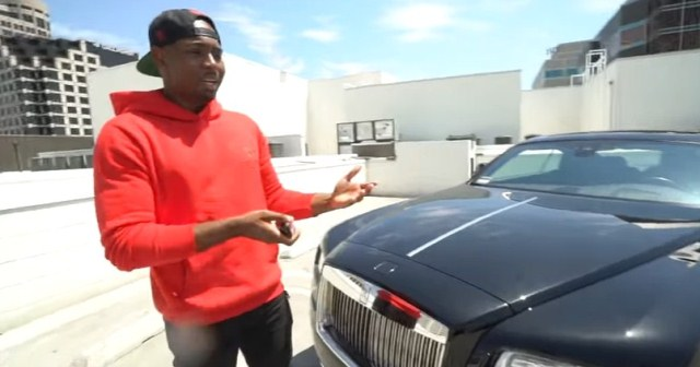 Nathanael Boucaud in front of his Rolls-Royce Wraith