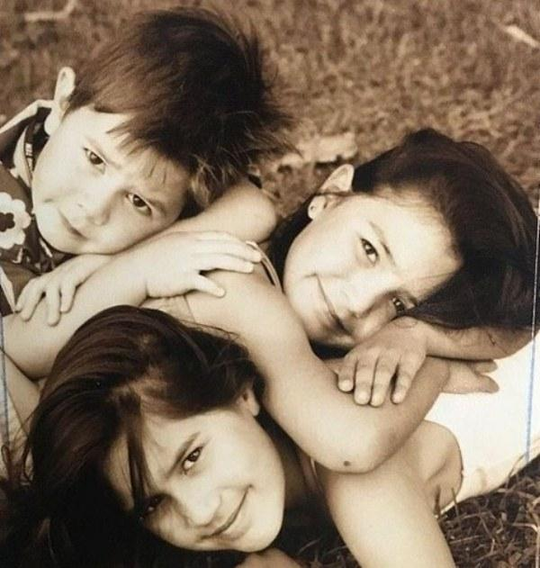 A childhood picture of KJ Apa with his sisters