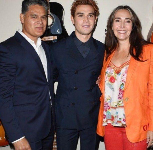 KJ Apa with his parents